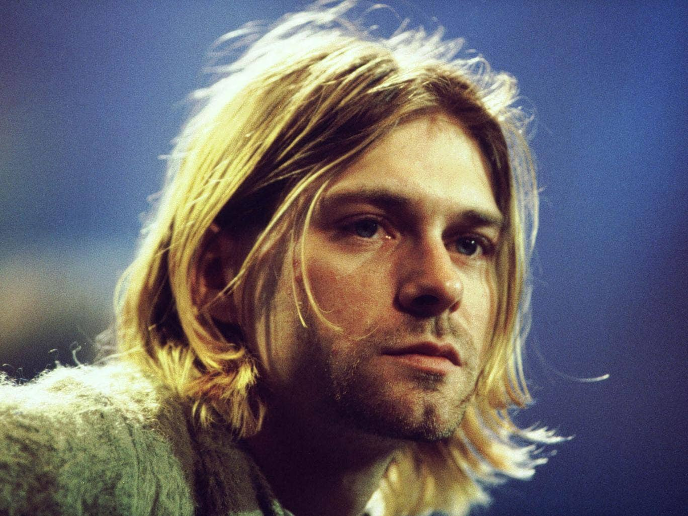 Kurt Cobain plays a gig with Nirvana in 1993, before his death the following year aged 27
