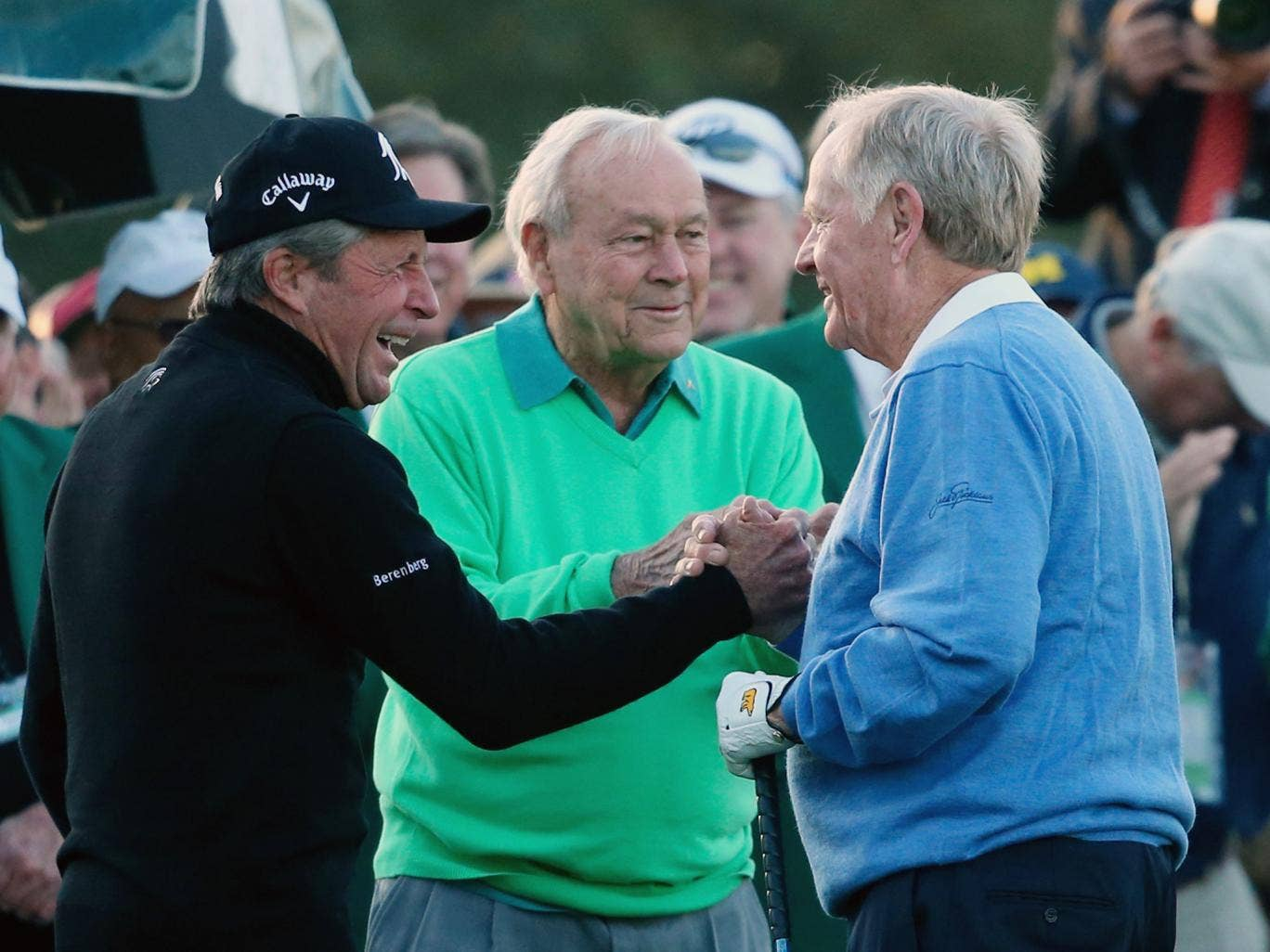 Honorary starters Gary Player, Arnold Palmer and Jack Nicklaus greet each other on the first tee