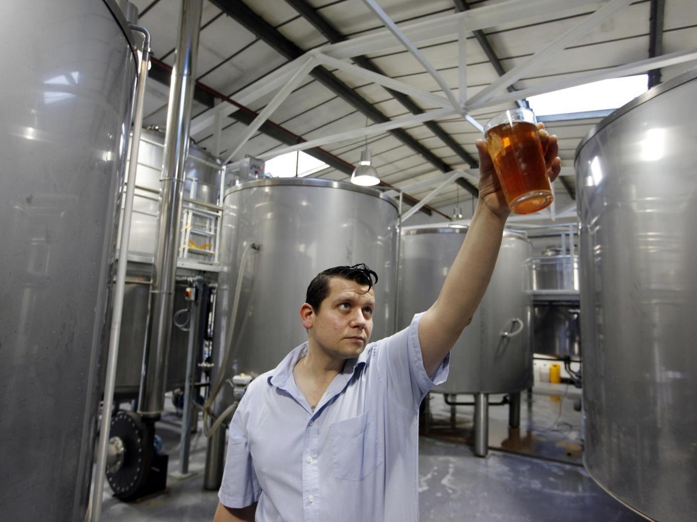 Beer baron: Ben Ott inspects his product