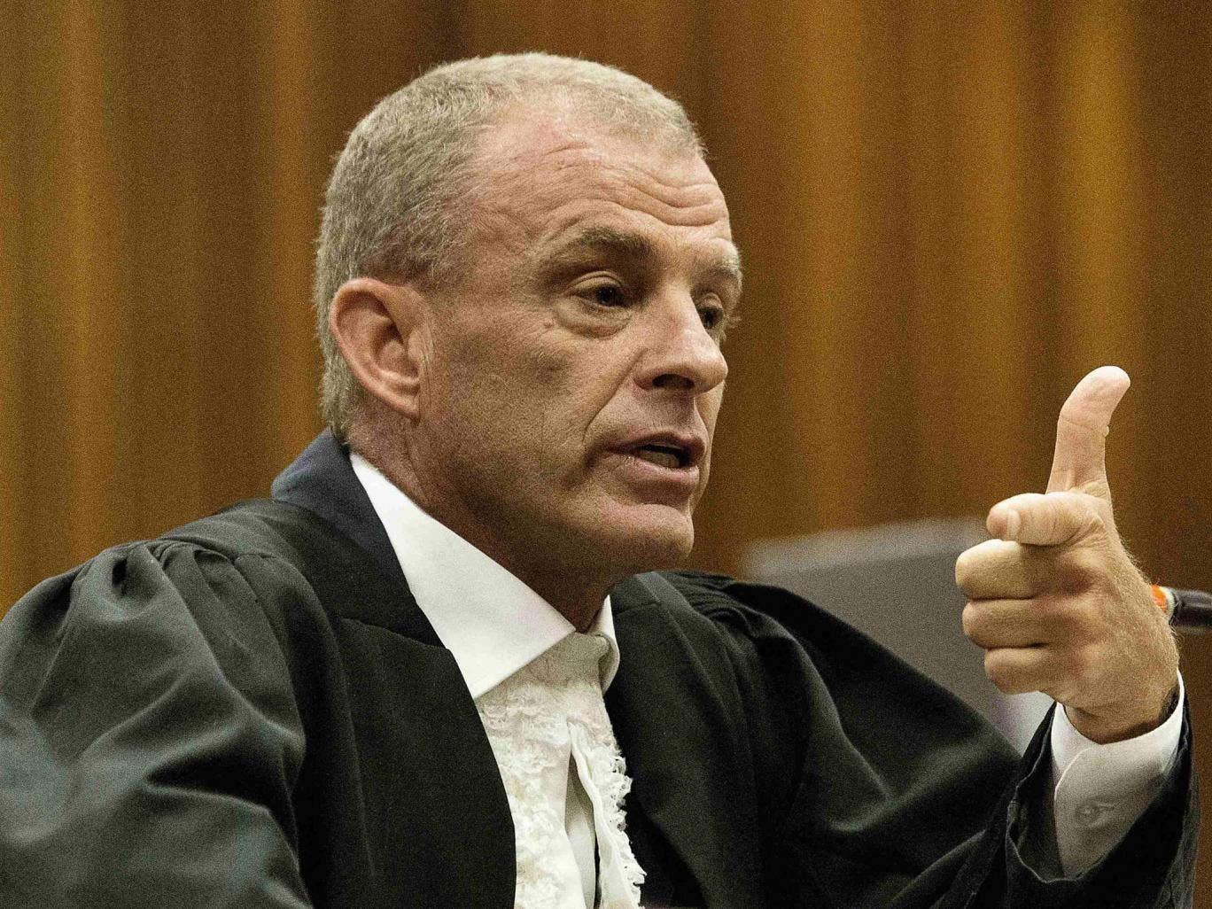 The state prosecutor Gerrie Nel cross examines the athlete Oscar Pistorius at the High Court in Pretoria yesterday