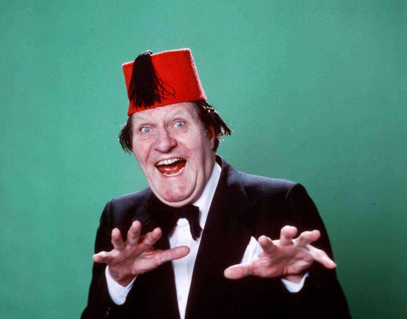 Hats off to him: Cooper wearing his trademark fez in the 1970s