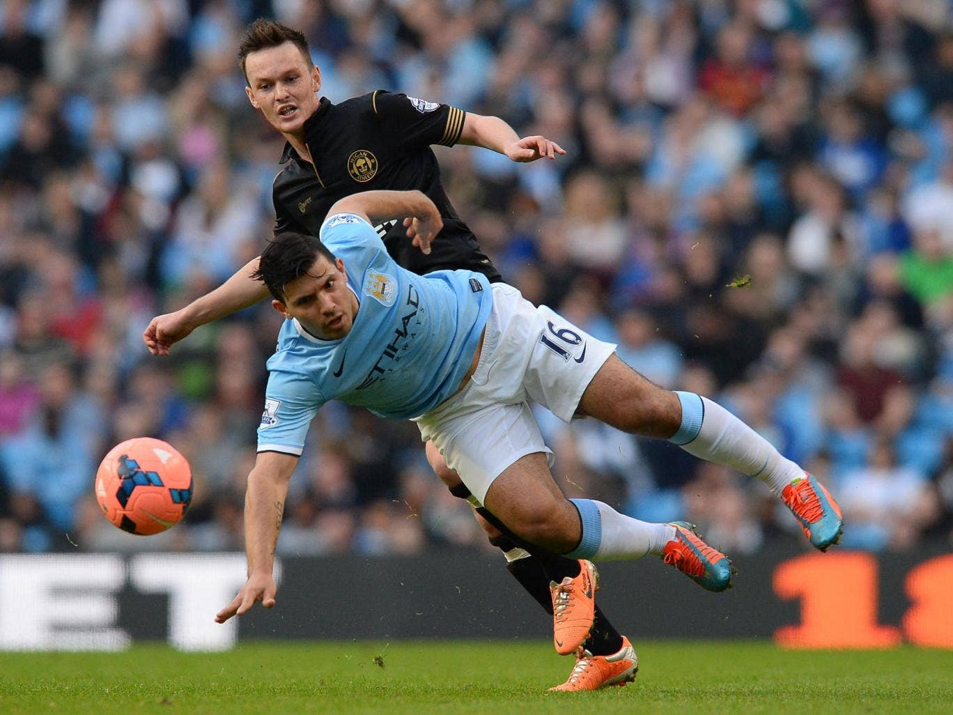 Josh McEachran tackles Manchester City's Sergio Aguero in Wigan's shock FA Cup quarterfinal victory