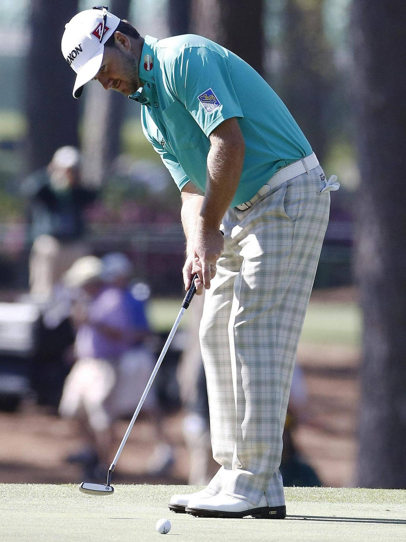 Graeme McDowell is the best putter on the PGA Tour this season but even he struggled on the fast greens yesterday