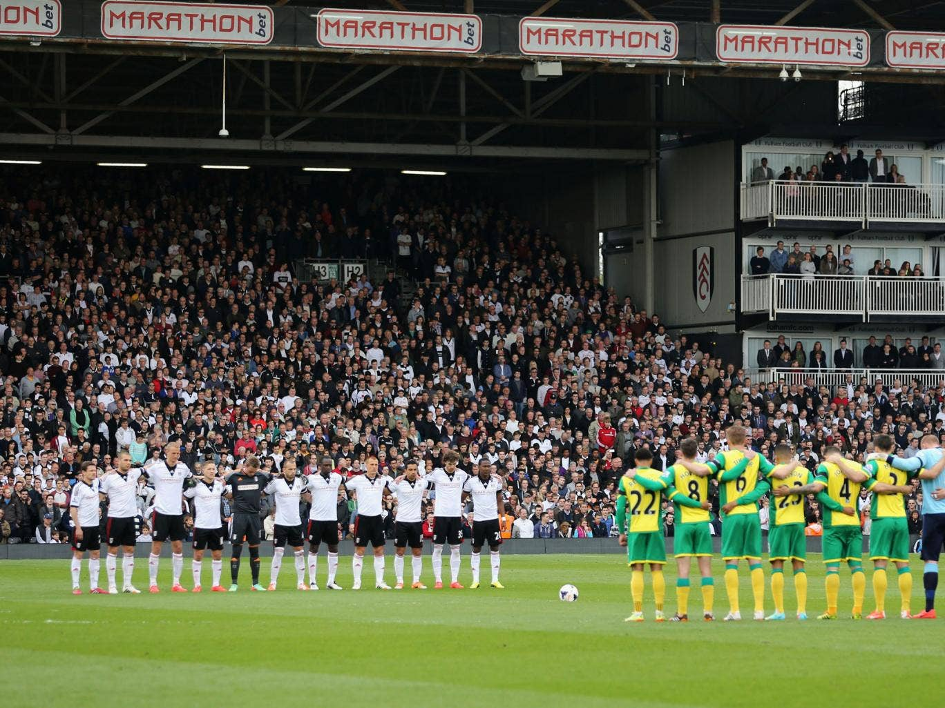 Players and fans observe a minute's silence to mark the 25th anniversary of the Hillsborough disaster