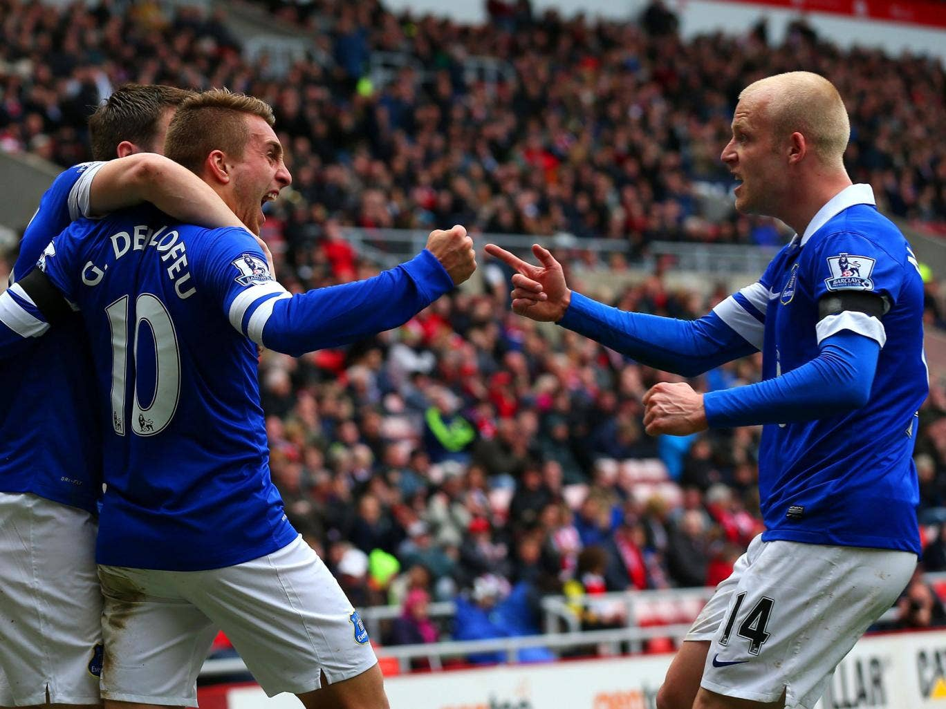 Seamus Coleman, Gerard Deulofeu and Steven Naismith of Everton celebrate after Wes Brown of Sunderland scores an own goal