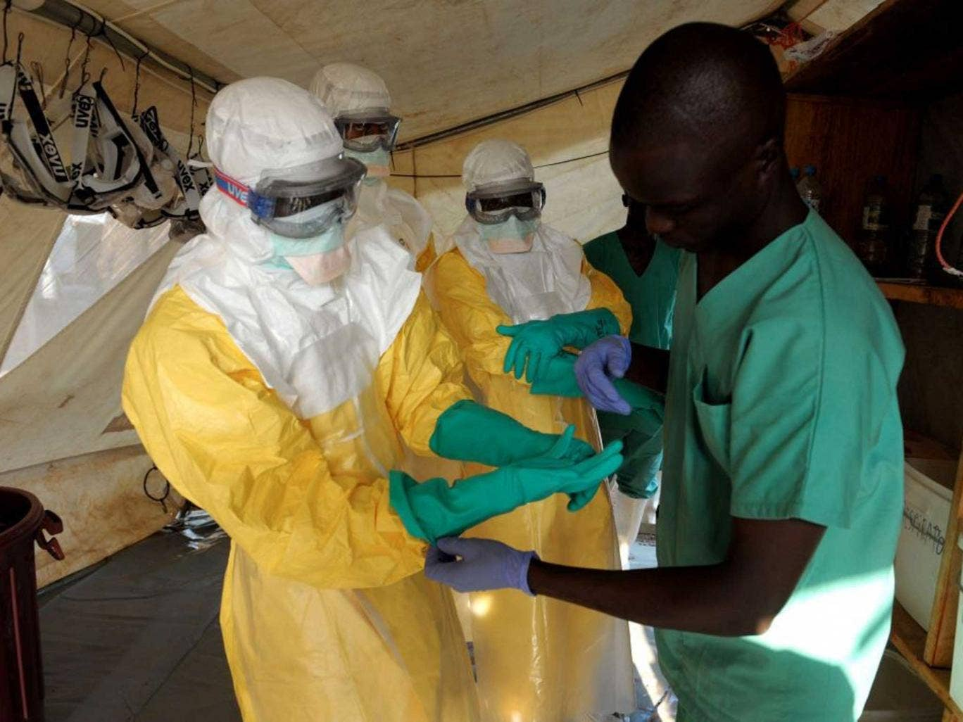Suit Up: Ebola is spread by contact with bodily fluids,  so protection  is vital