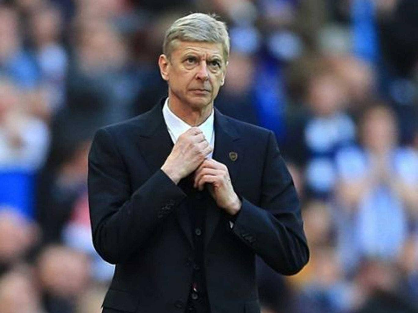 Smartly turned out: Arsène Wenger adjusts his attire but his critics say that the renowned innovator has forgotten how to adapt his team and tactics