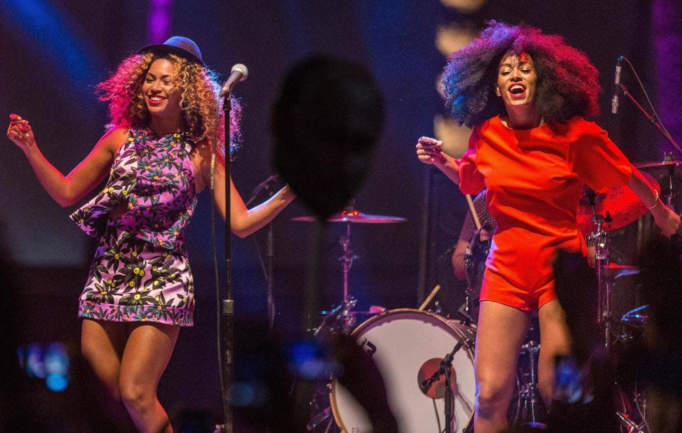 Singer Beyonce performs with her sister Solange onstage on Day 2 of the 2014 Coachella Valley Music & Arts Festival