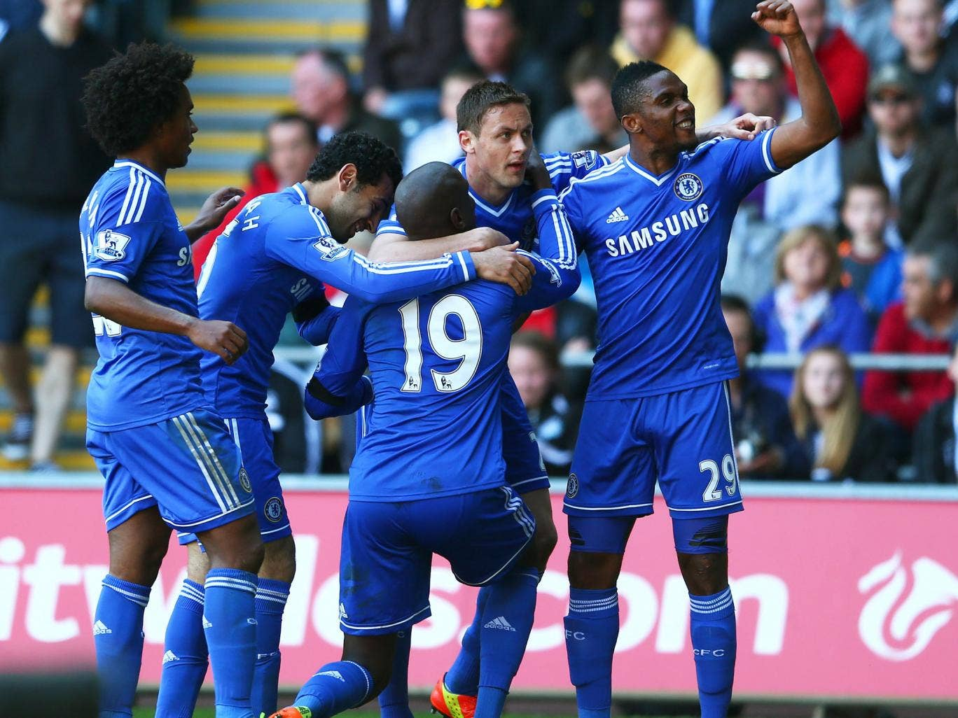 Demba Ba (centre) celebrates his winning goal with Chelsea team-mates