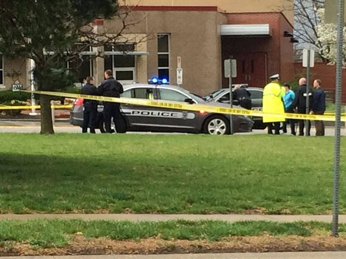 Authorities respond to the Jewish community center after a shooting in Overland Park