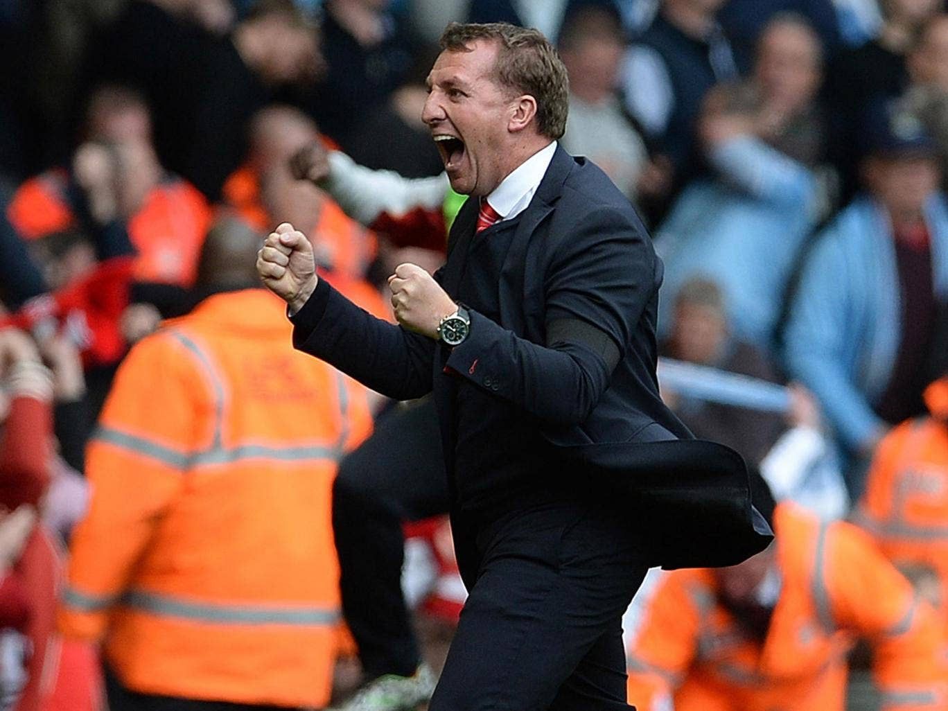 Brendan Rodgers celebrates the 3-2 victory over Manchester City that keeps his Liverpool side top of the Premier League