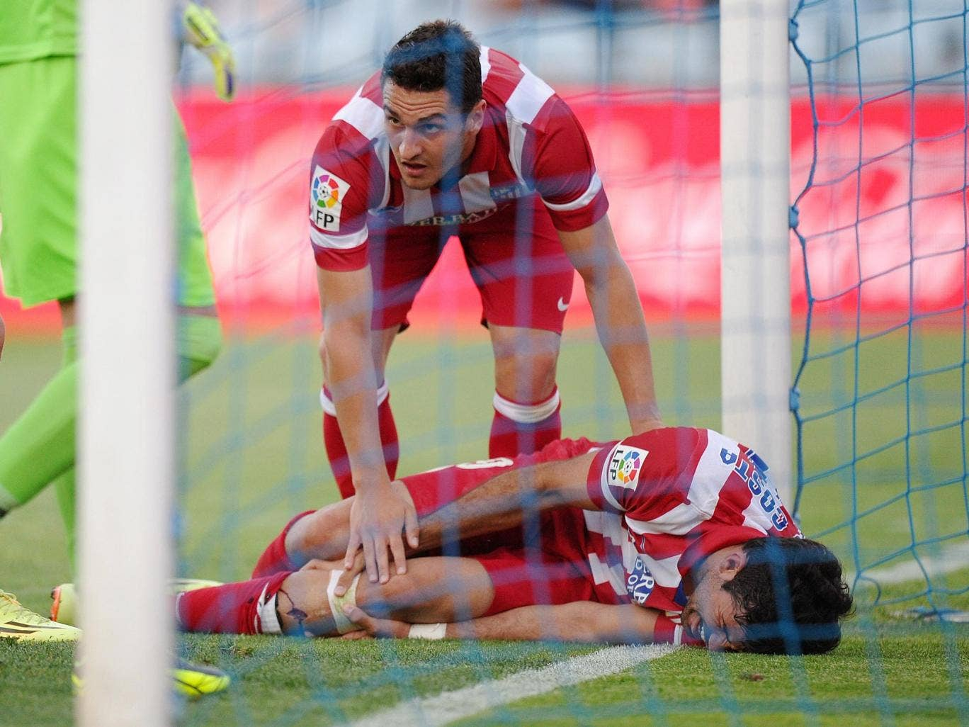 Diego Costa lies in pain after hitting the post when scoring in Atletico Madrid's 2-0 win over Getafe