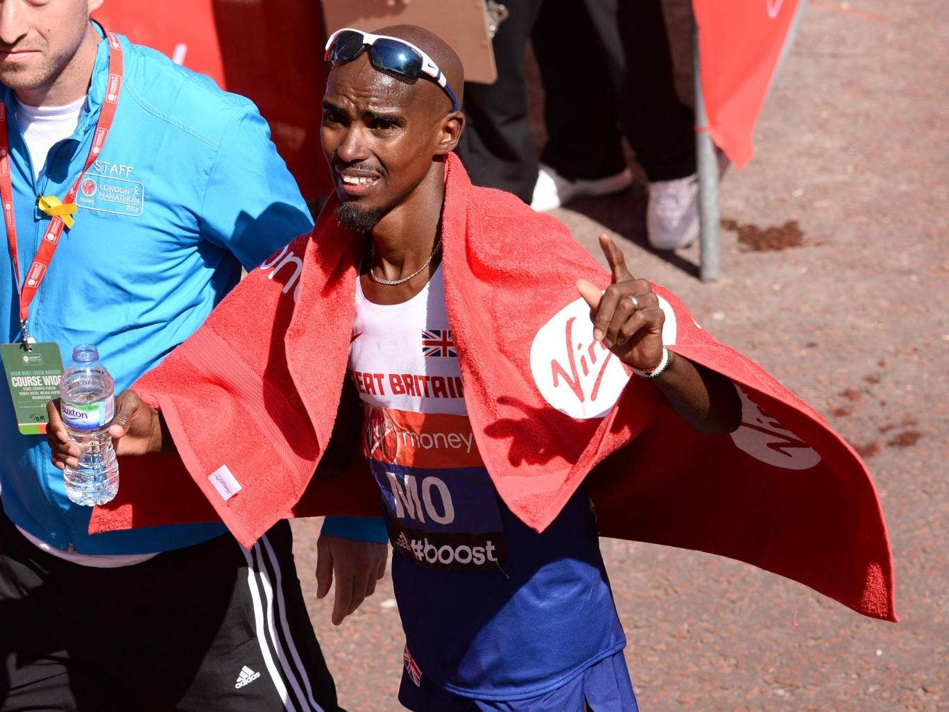 Mo Farah salutes the crowd after his London Marathon debut