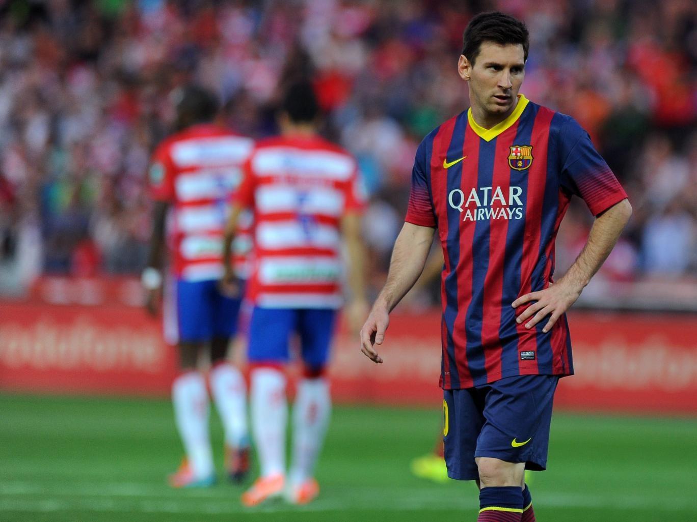 Barcelona forward Lionel Messi reacts during the La Liga defeat to Granada
