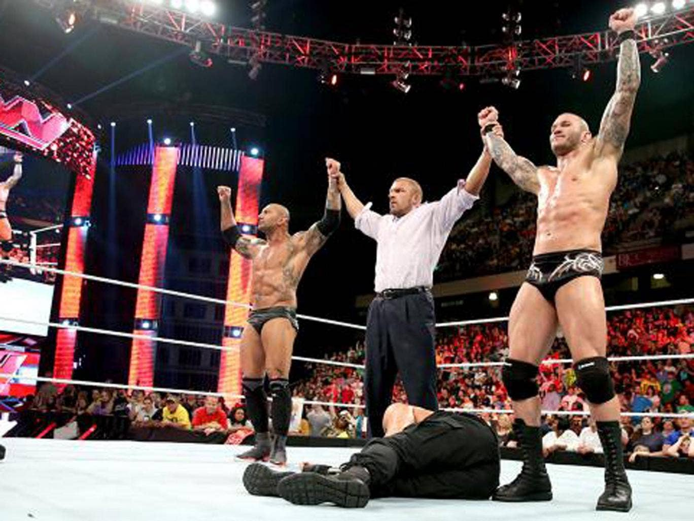 Batista, Triple H and Randy Orton reunite as Evolution to take down The Shield