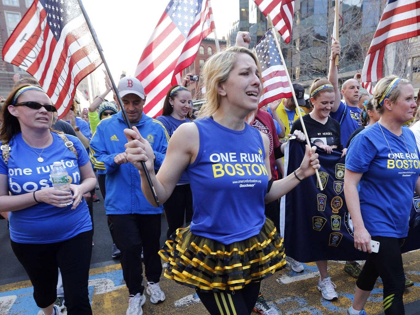 Boston Marathon bombing survivors, family members and supporters joined the relay runners for the final half-block to the finish