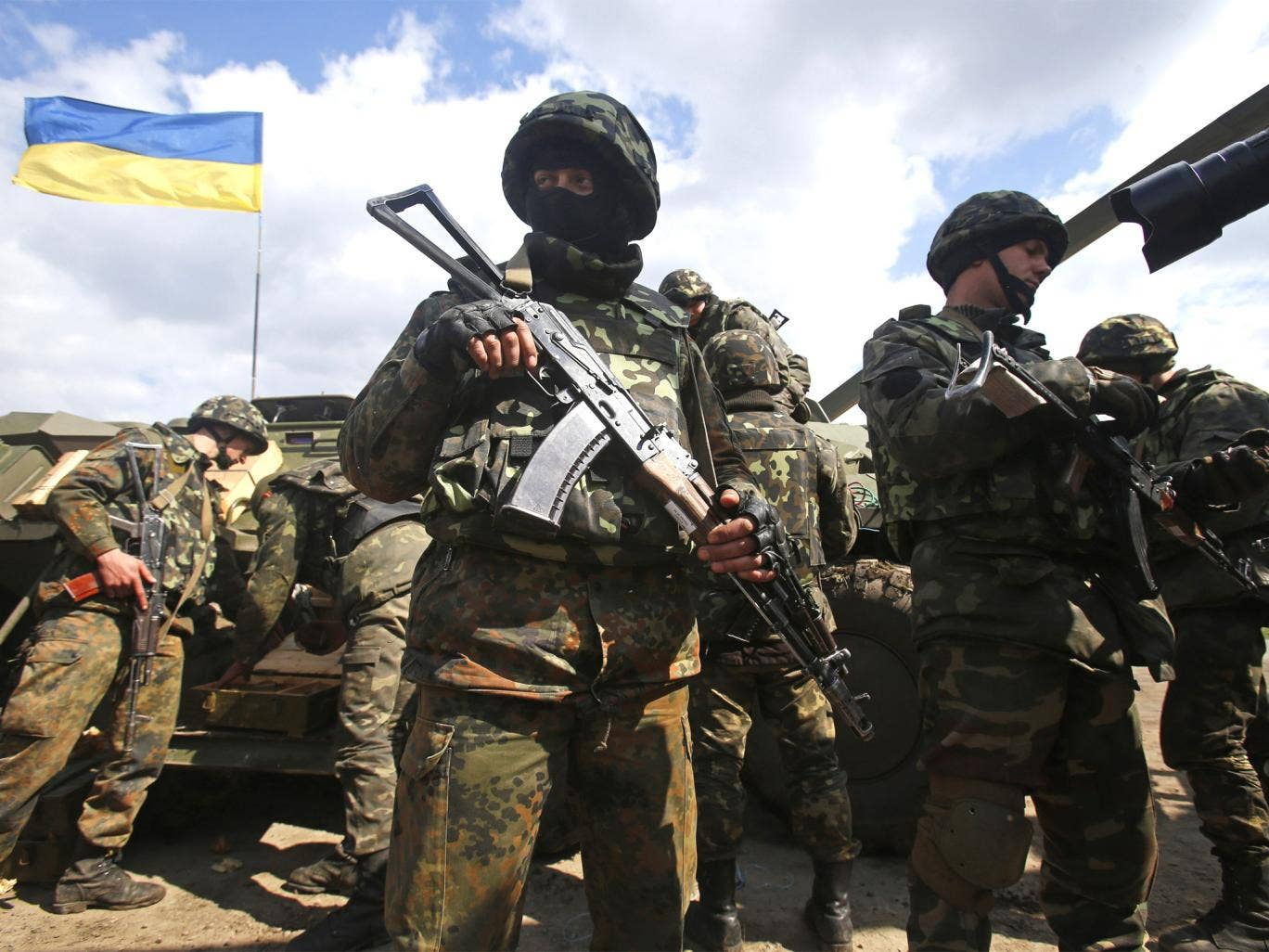 Ukrainian army troops receive ammunition in a field on the outskirts of Izyum in eastern Ukraine