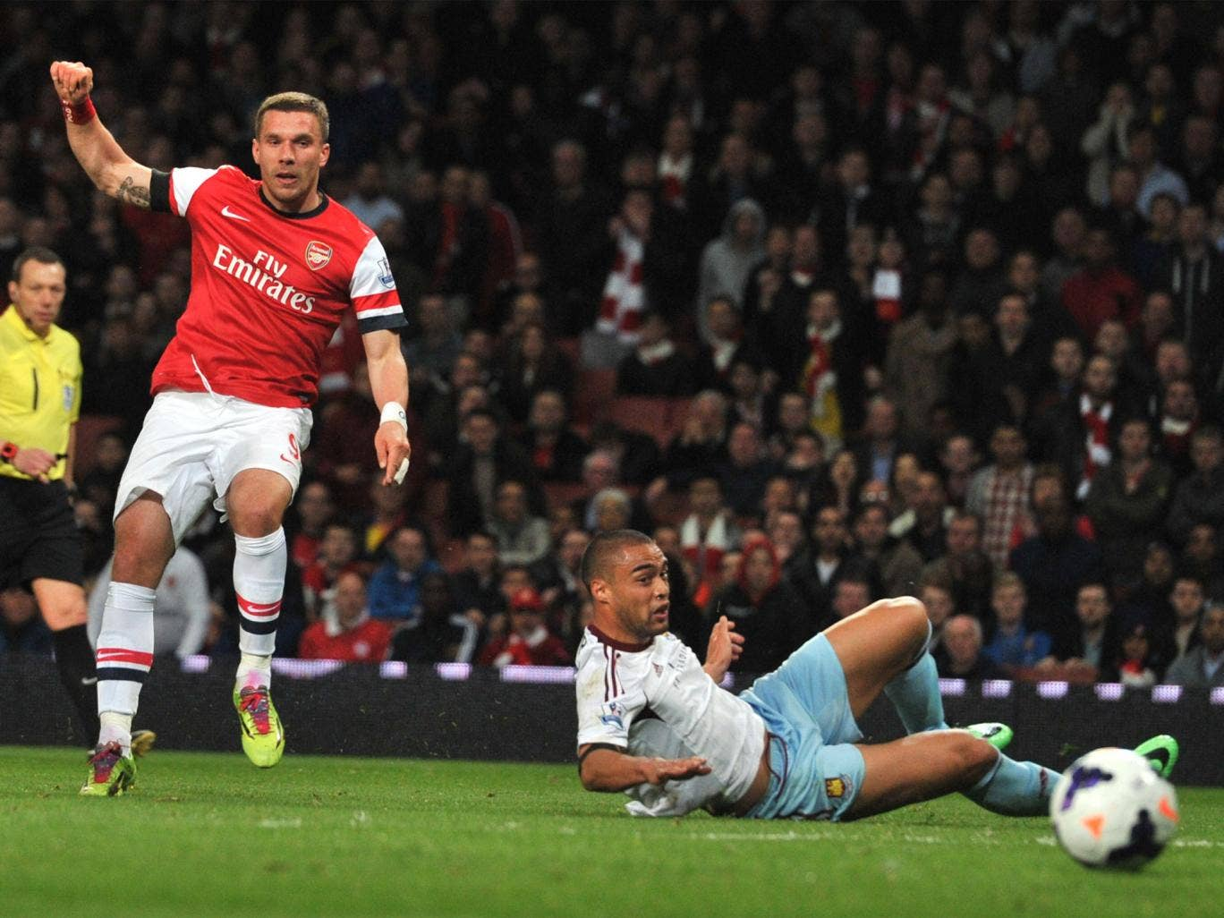 Lukas Podolski equalises with a precise, powerful finish