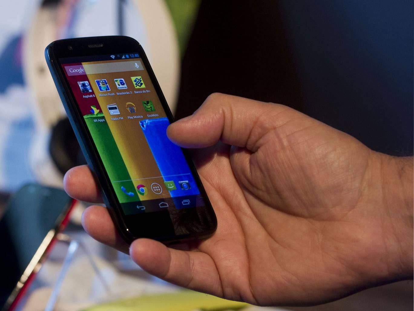 The new low cost smartphone of Motorola, 'Motorola Moto G', is displayed in Sao Paulo, Brazil on November 13, 2013. The smartphone, with dimensions 65.9mm W x 129.9mm H x 6.0 - 11.6mm D is equipped with a Qualcomm Snapdragon 400 with quad-core 1,2 GHz CPU