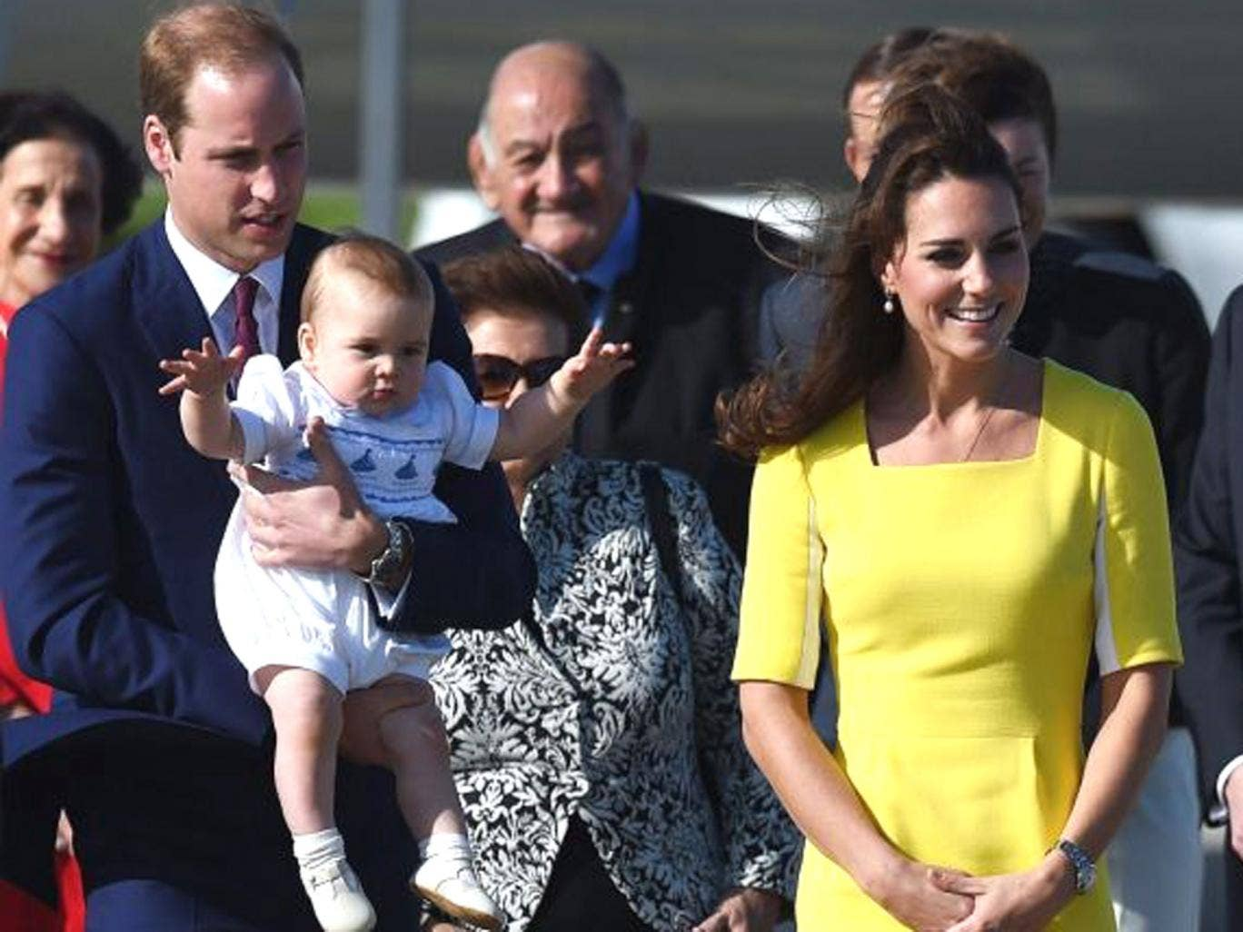 Britain's Prince William, Duke of Cambridge (L), Catherine, Duchess of Cambridge (2-R) and son Prince George arrive for their Australian tour in Sydney, 16 April 2014.