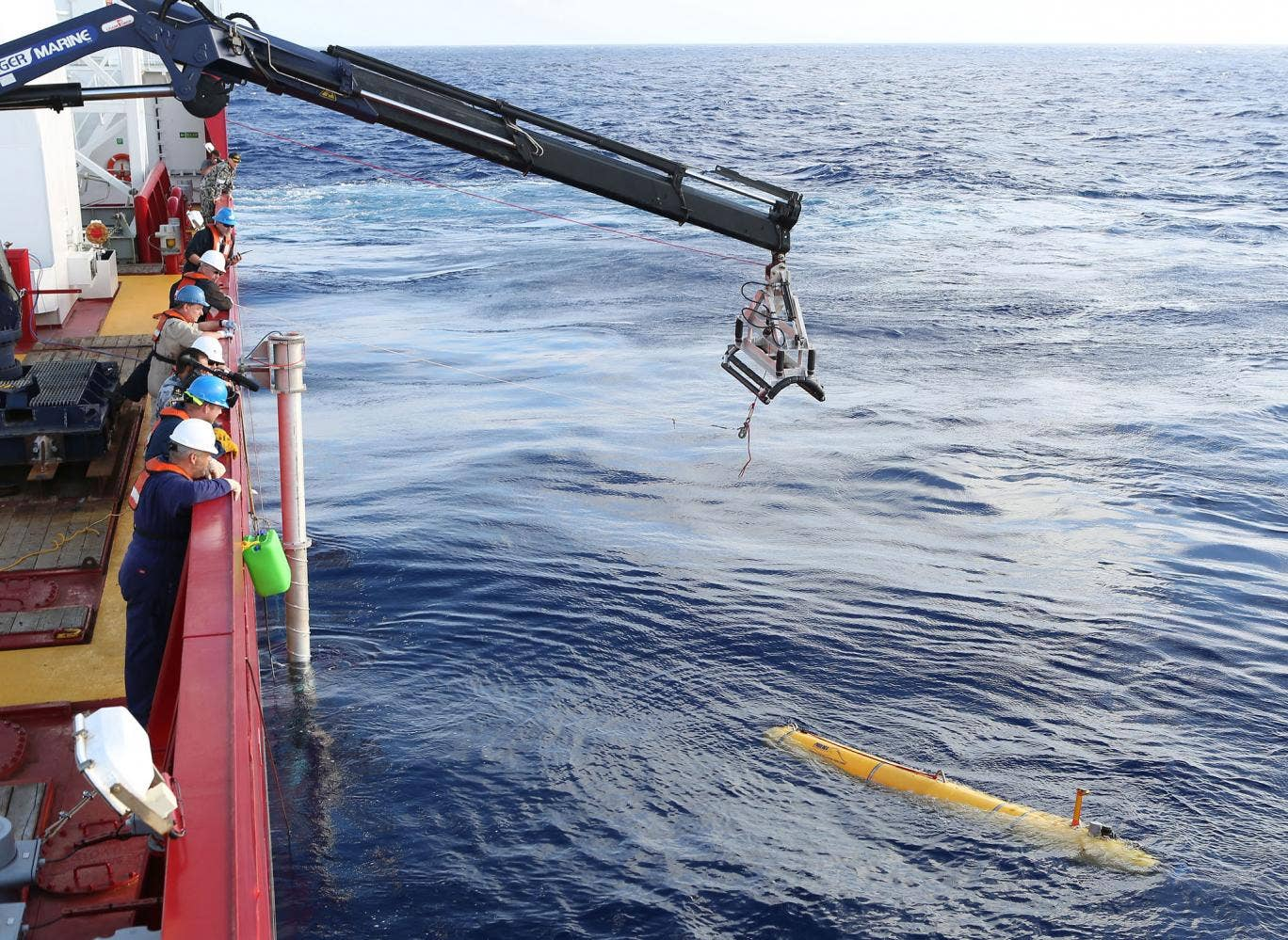 Bluefin 21 is craned over the side of Australian Defence Vessel Ocean Shield in the search for missing Malaysia Airlines flight MH370