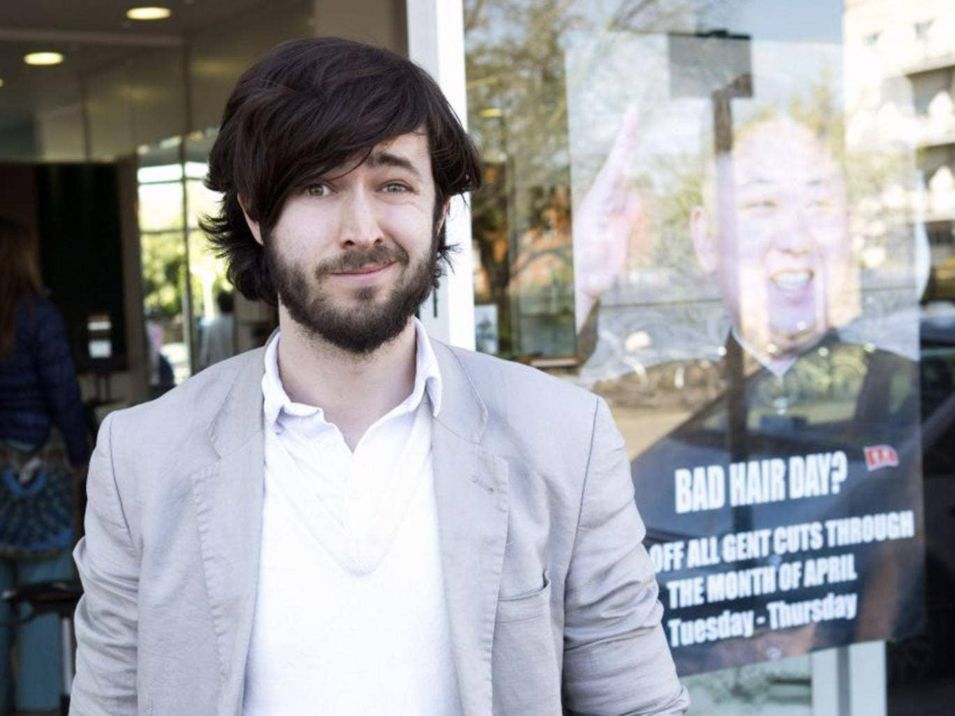 From long to Jong: Guy Pewsey outside Mo Nabbach's M&M Hair Academy in west London before the haircut