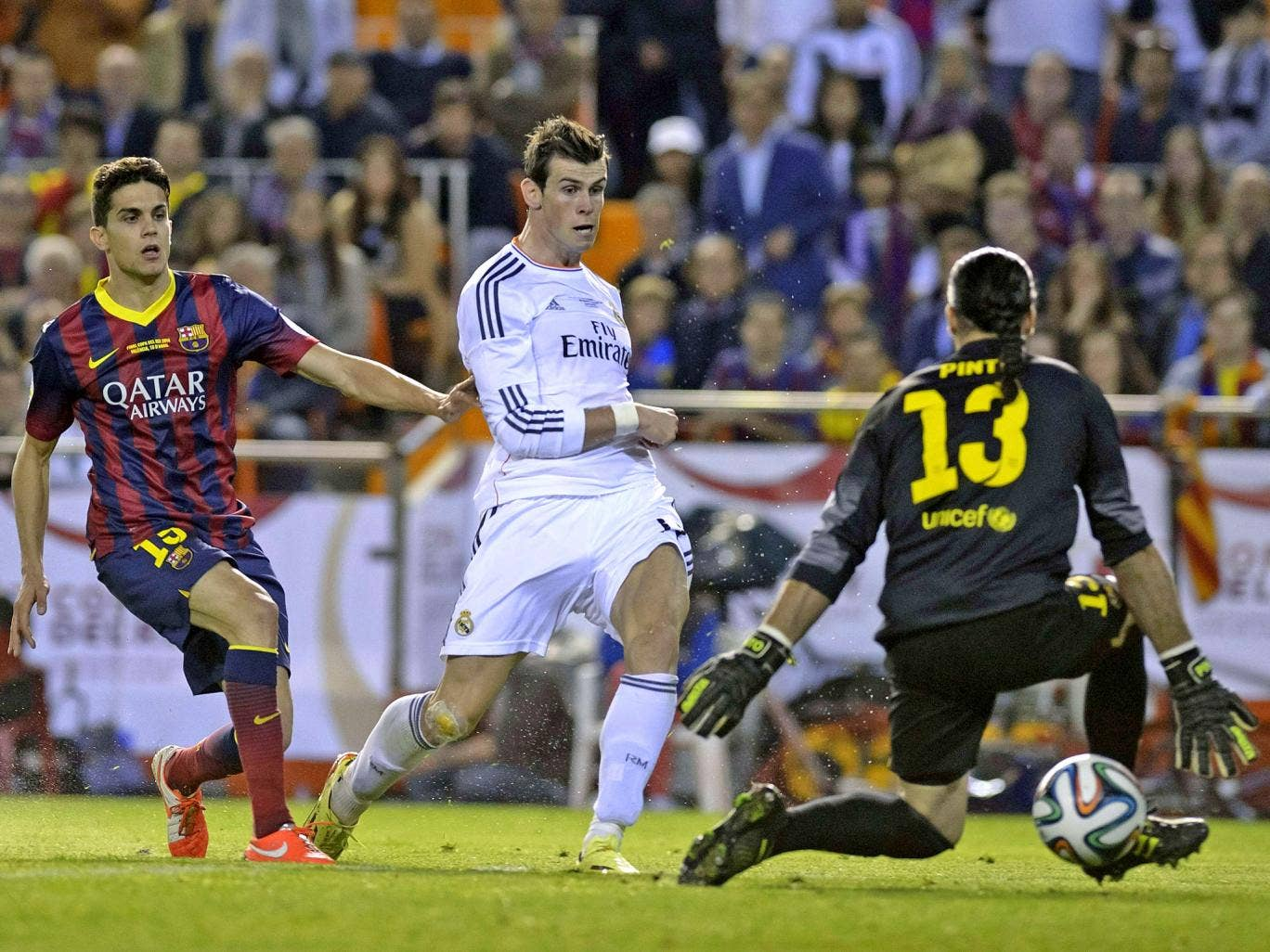 Gareth Bale dribbled from inside his own half and finished calmly late in the final to hand Real a 2-1 win at the Mestalla in Valencia