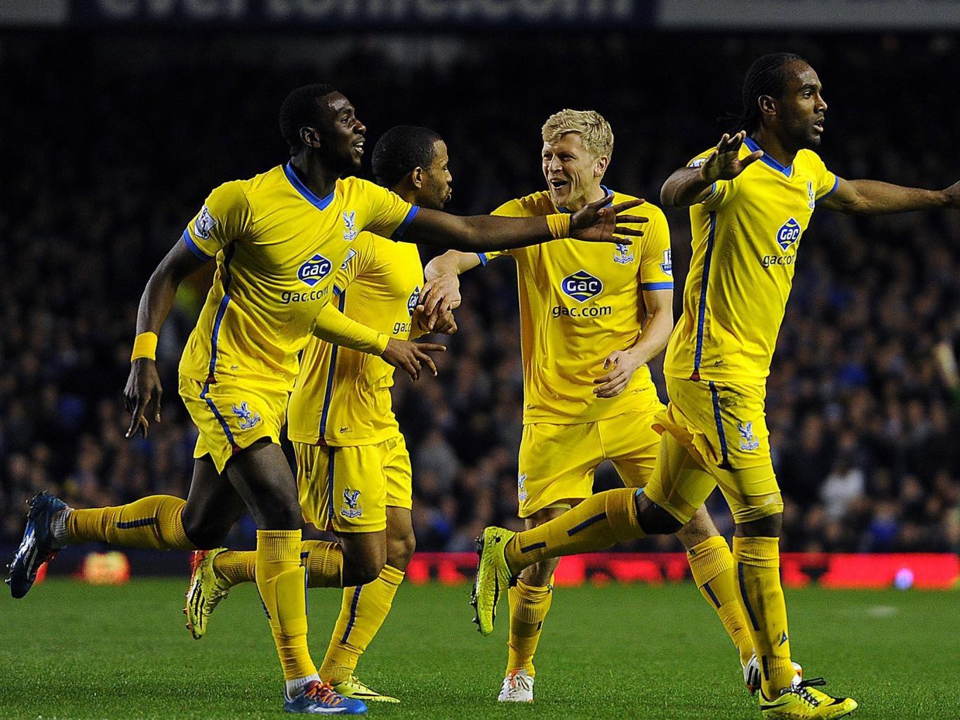 Cameron Jerome (far right) celebrates scoring Palace's third goal against Everton on Wednesday