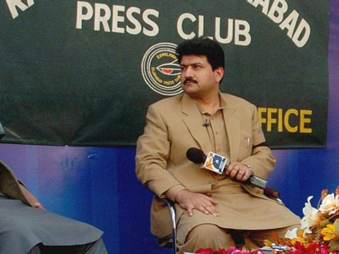 Police say Hamid Mir, a host on the private television broadcaster Geo, was wounded in the attack Saturday near Karachi's airport