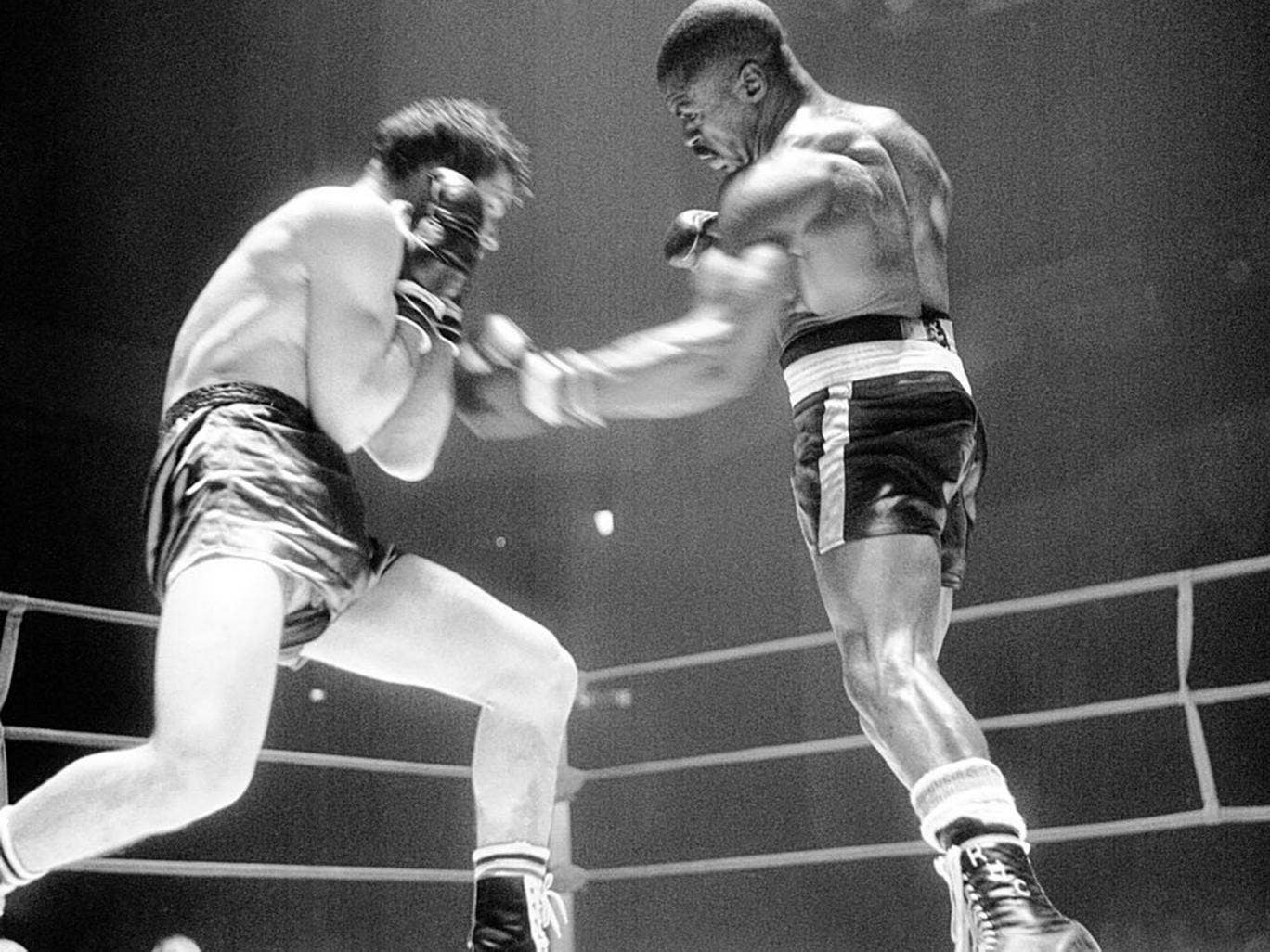 Carter, right, on his way to knocking out the Italian boxer Fabio Bettini in Paris in 1965