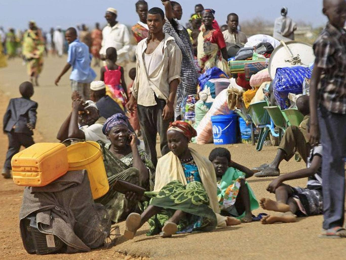 South Sudanese fleeing an attack on the South Sudanese town of Rank, wait to register after arriving at a border gate in Joda, along the Sudanese border