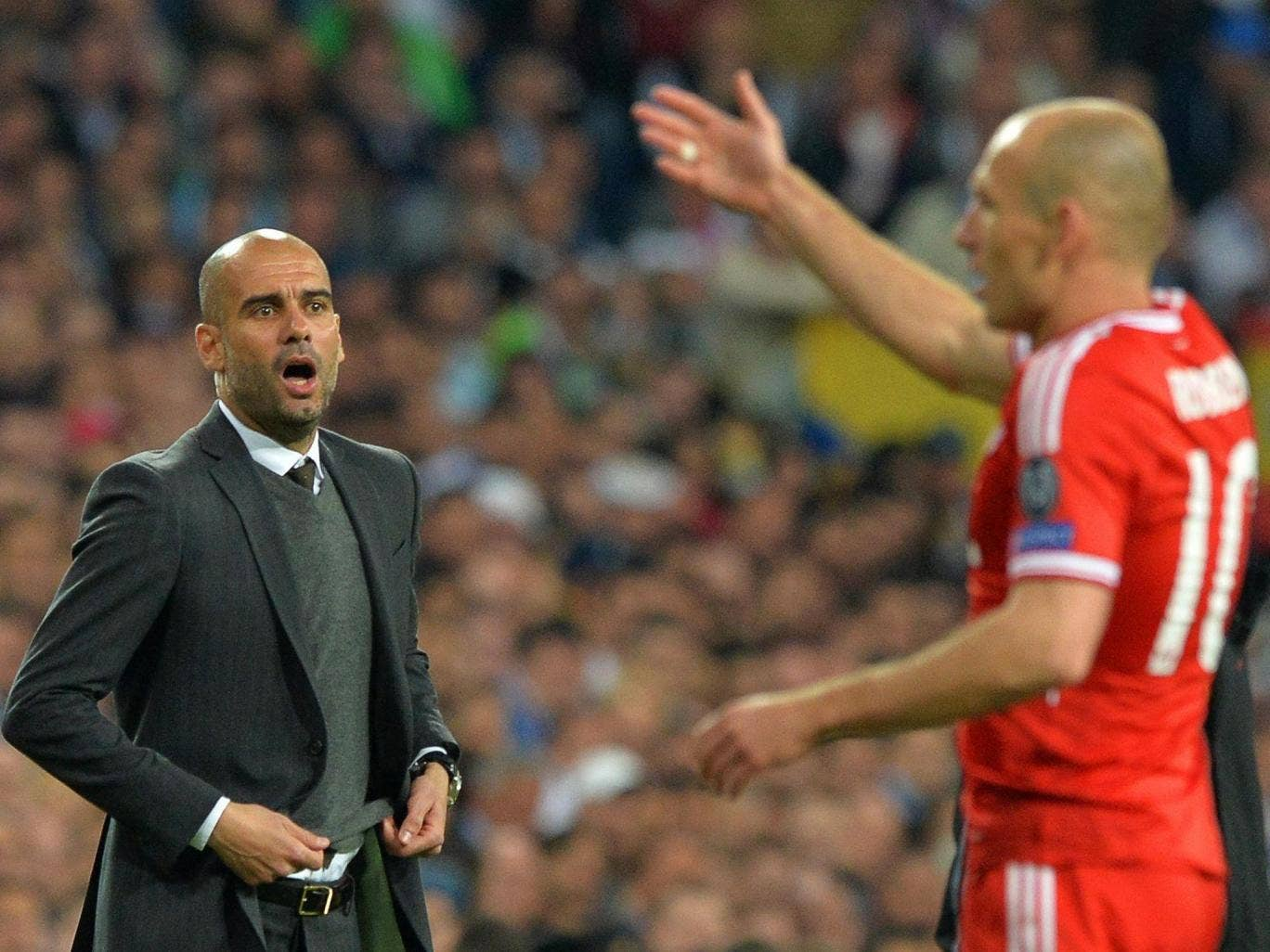 Pep Guardiola shouts out orders to Arjen Robben during Wednesday's defeat