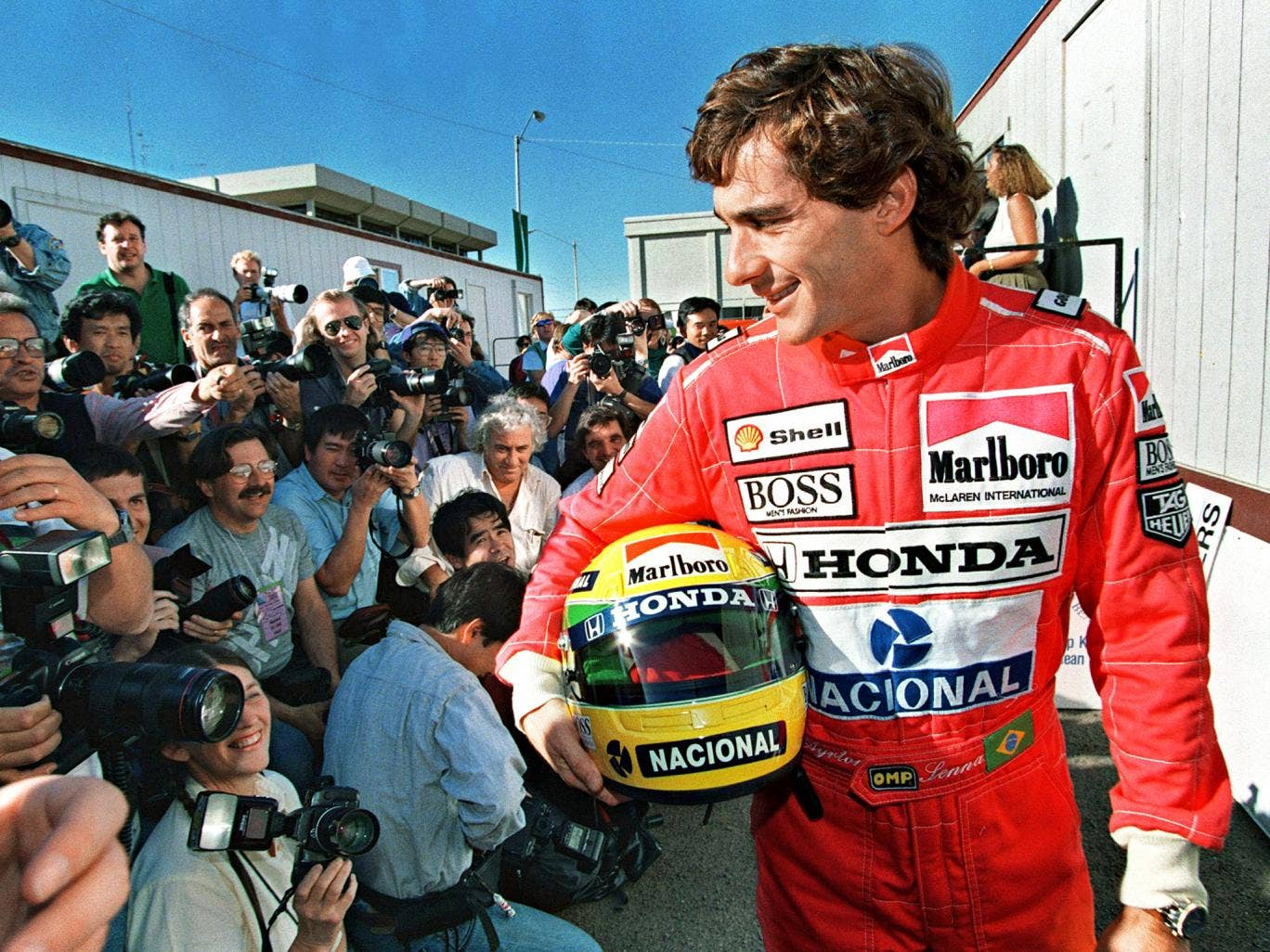Ayrton Senna, the defending champion, poses for photographers in Phoenix on the eve of the 1991 F1 season