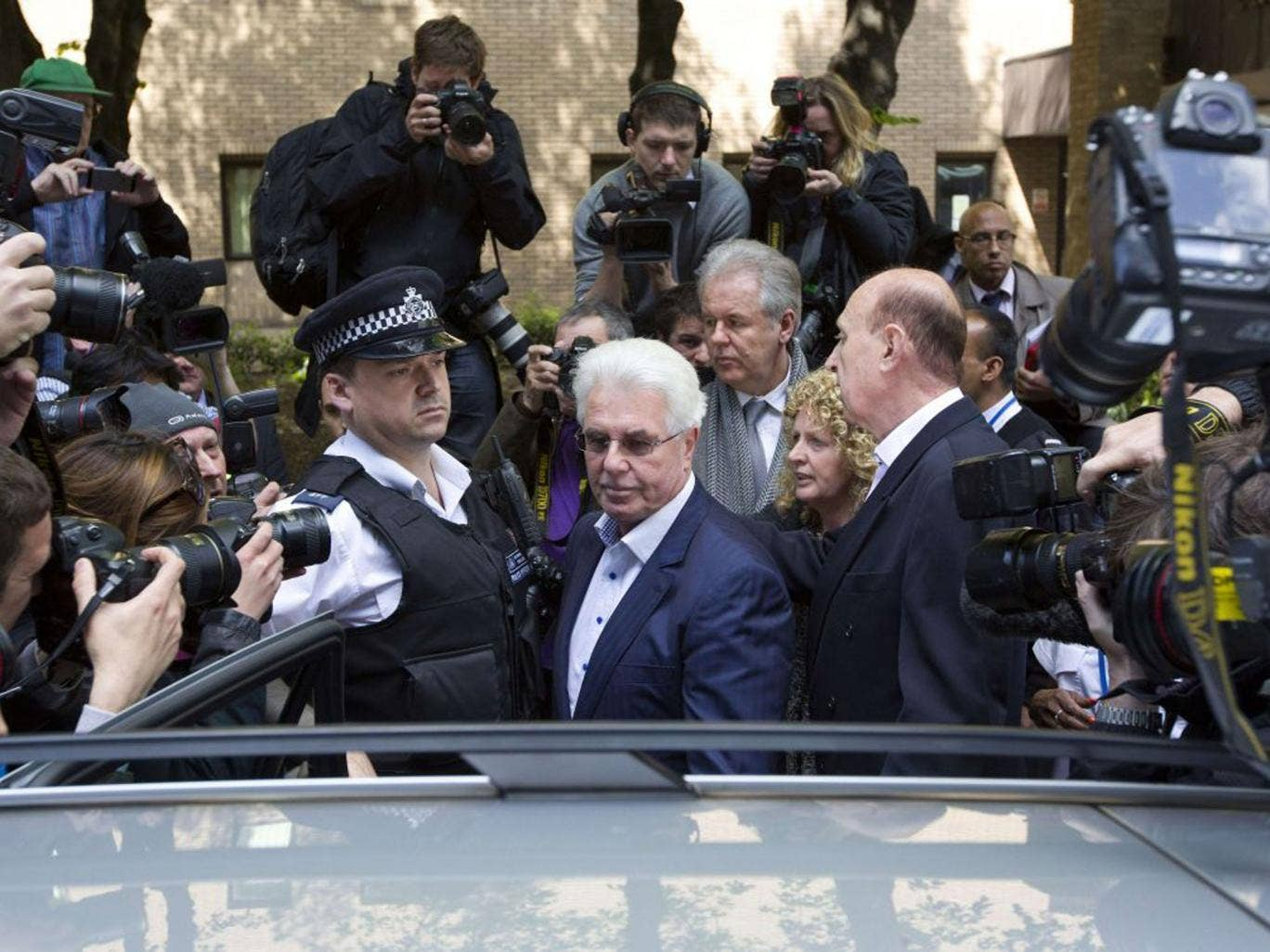 Max Clifford remained silent when he left Southwark Crown Court