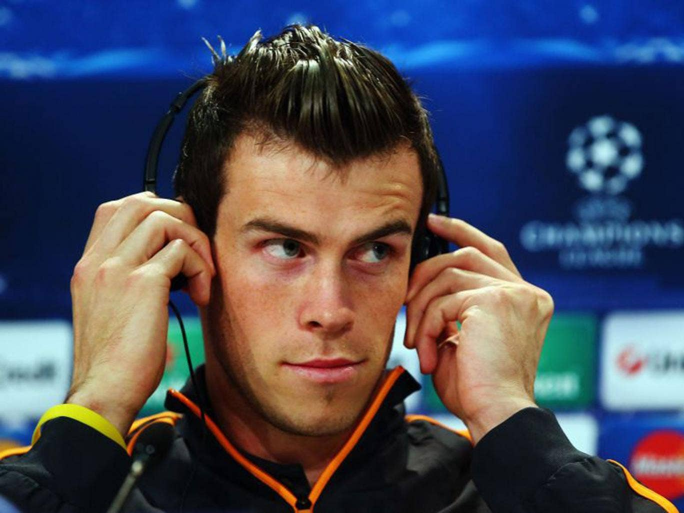 Real Madrid's Gareth Bale keeps cool in front of the press at the Allianz Arena yesterday