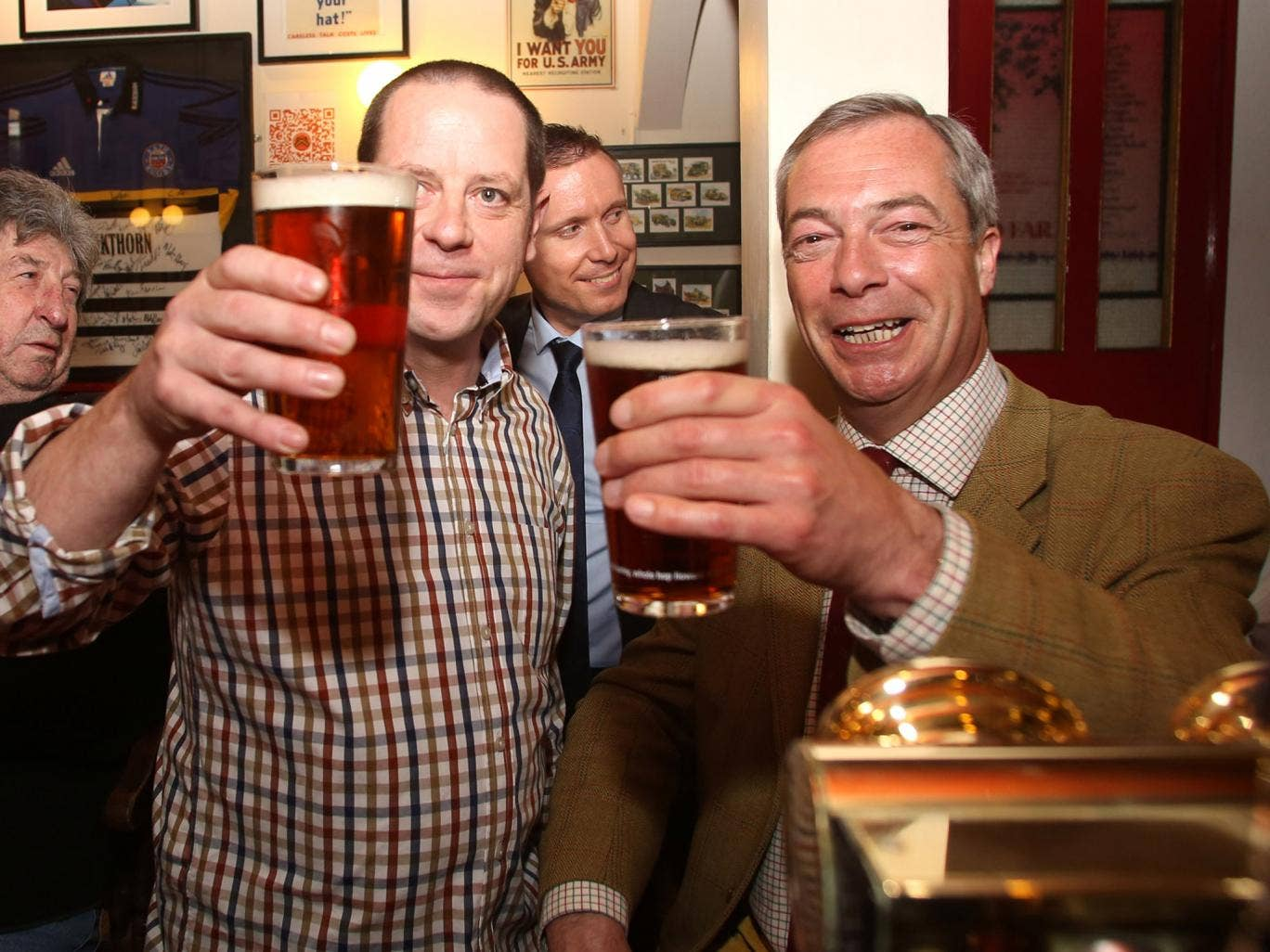 Ukip leader Nigel Farage enjoys a pint with Paul Alvis, the landlord of Volunteer Rifleman's Arms, as he visits Bath to meet with party members