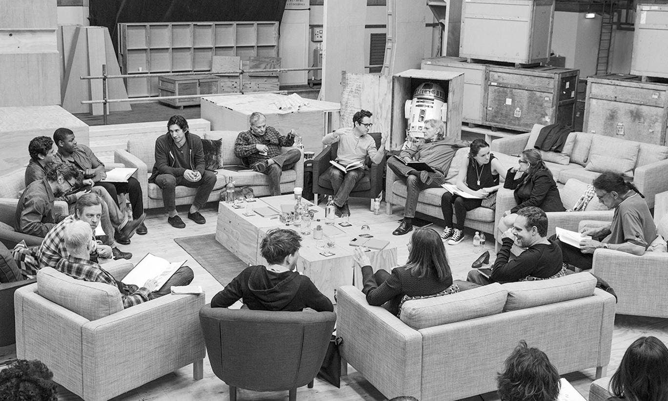 The Episode VII cast during a read-through at Pinewood Studios. (clockwise from top center right) Writer/Director/Producer J.J Abrams, Harrison Ford, Daisy Ridley, Carrie Fisher, Peter Mayhew, Producer Bryan Burk, Lucasfilm President and Producer Kathleen