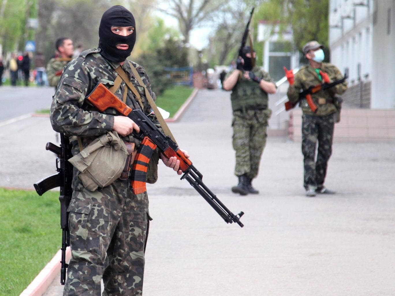 Pro-Russian militants block access to the regional police office in Luhansk