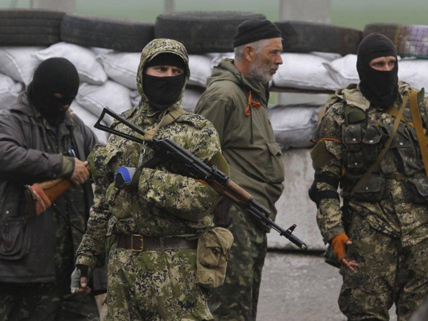 Pro-Russian masked armed militants guard barricades near Slovyansk on Wednesday