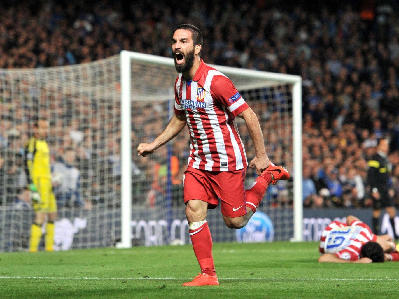 Arda Turan celebrates after soring Madrid's third