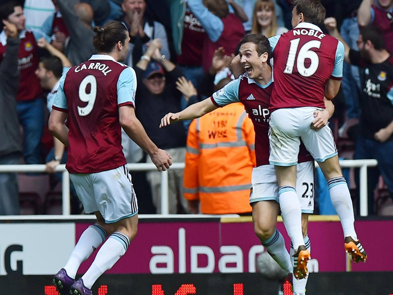 Stewart Downing celebrates with Andy Carroll and Mark Noble after scoring West Ham's second in the 2-0 win over Tottenham