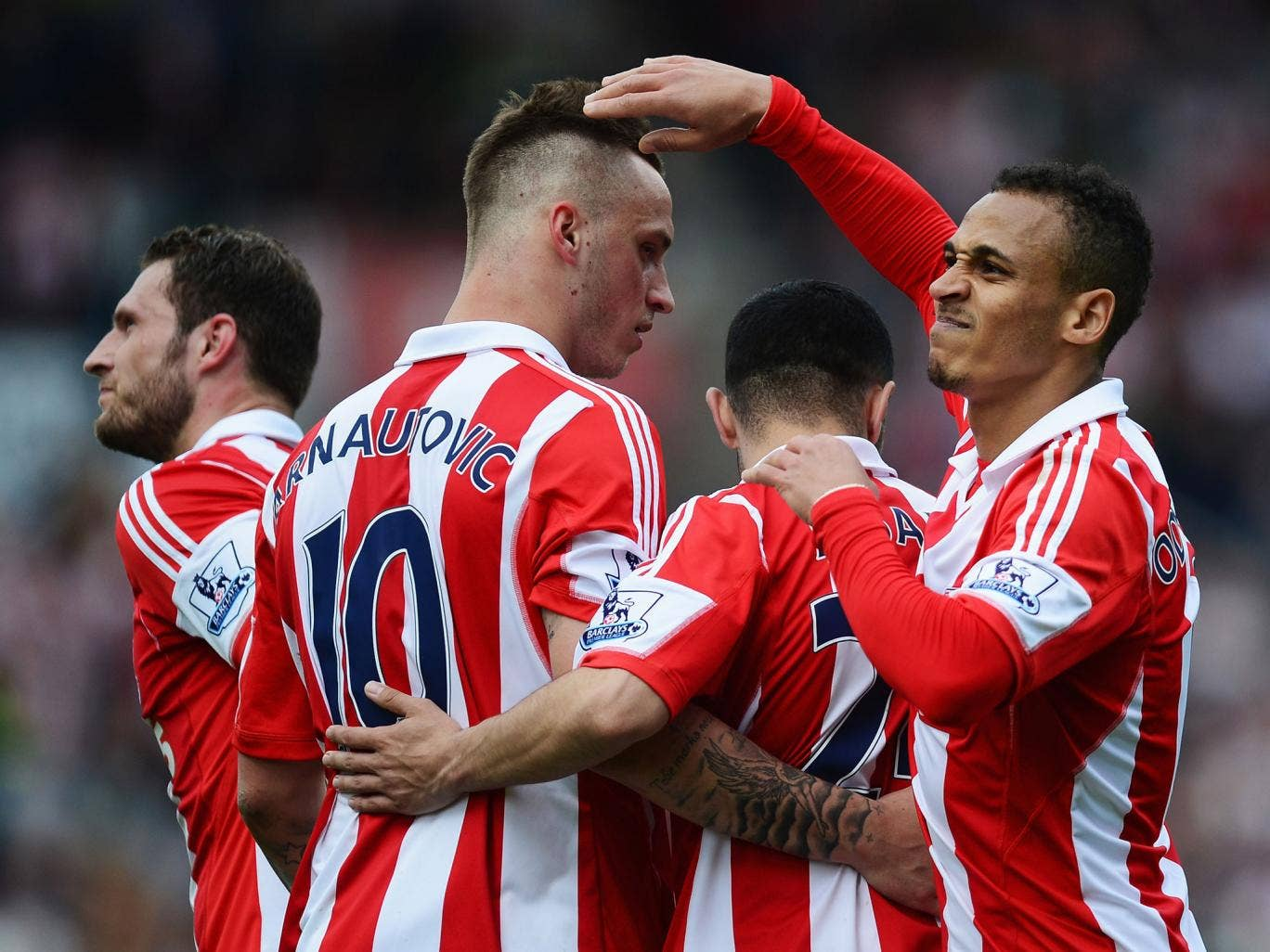 Stoke players celebrate after Peter Odemwingie's opening goal