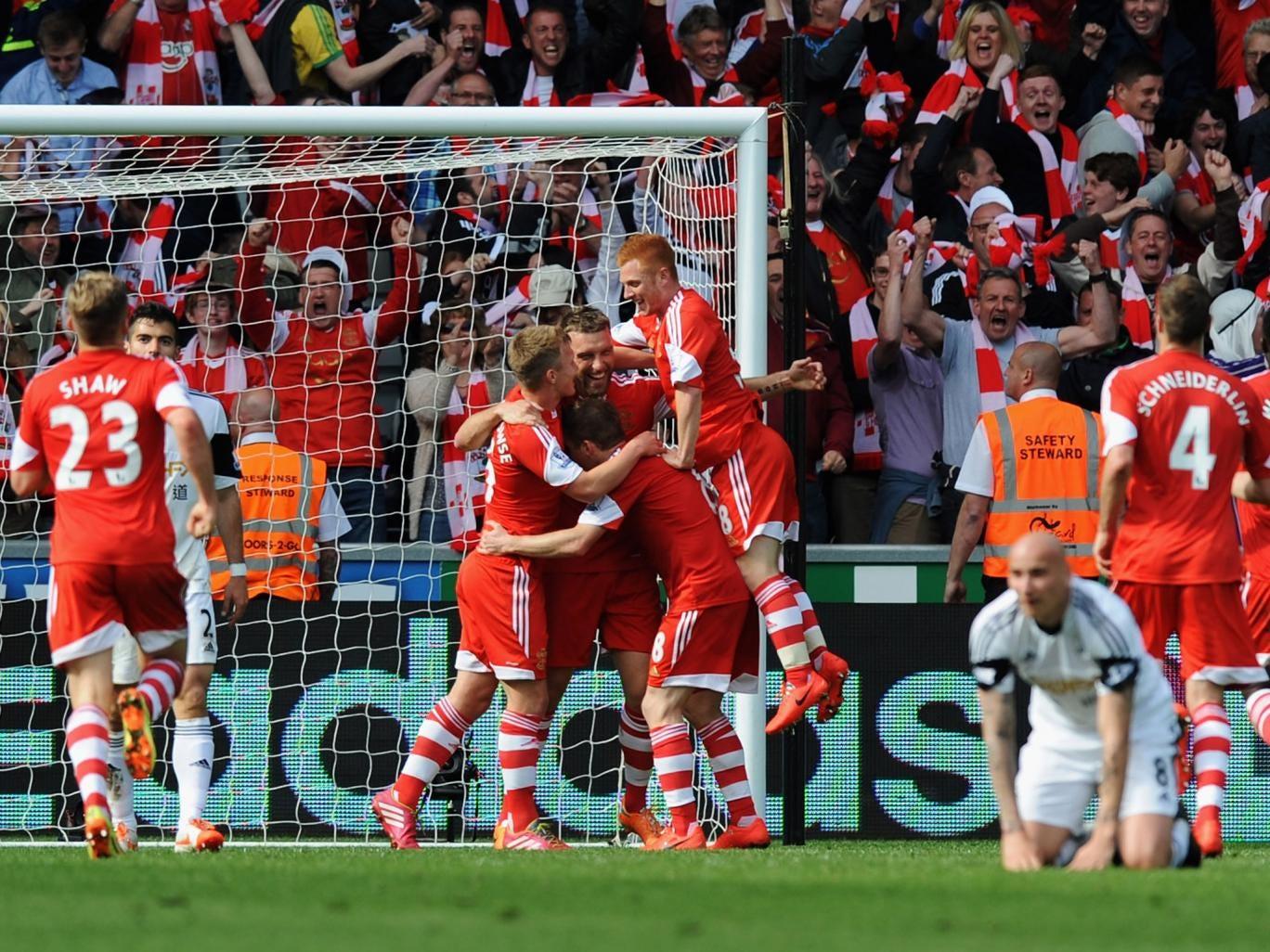 Rickie Lambert celebrates with his teammates after scoring the winning goal