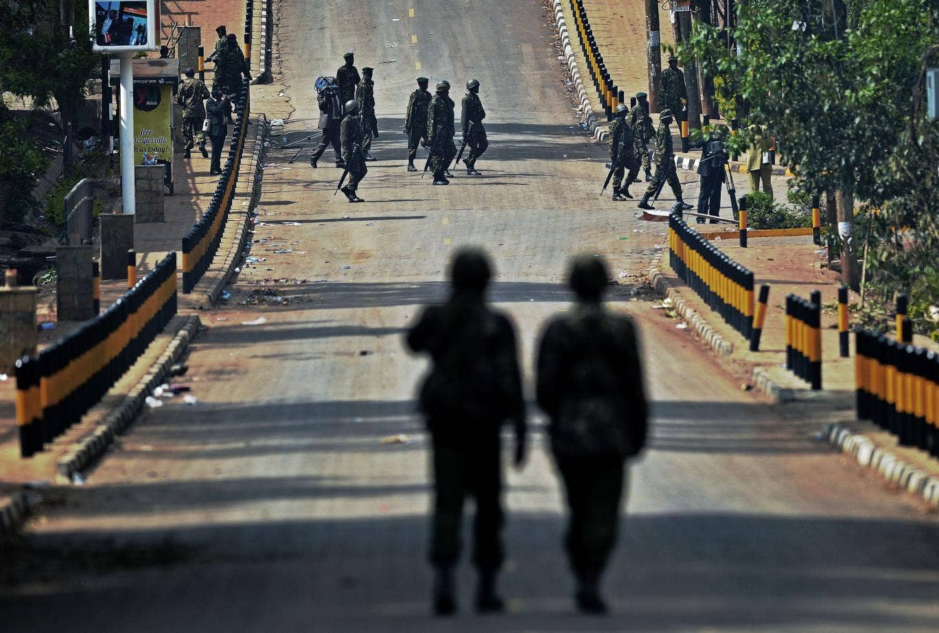 Kenyan soldiers walk on the road outside the Westgate shopping mall in Nairobi, which was attacked by al Shabaab militants last September, leaving 67 people dead. Kenya has blamed the al-Qa'ida-linked Somali group for a string of further attacks in the co