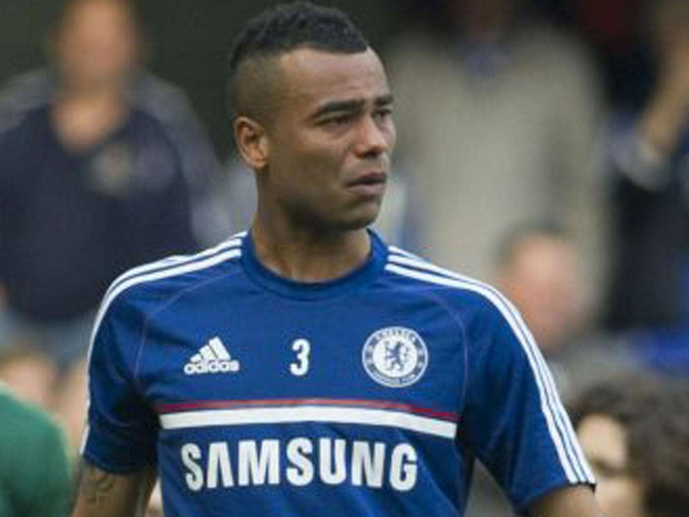 Ashley Cole looks devastated as he walks around the Stamford Bridge pitch after the match on Sunday