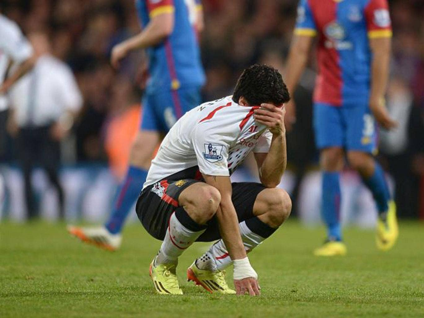 Liverpool striker Luis Suarez is distraught after drawing the match against Crystal Palace where the Uruguayan had equalled the record number of goals in a Premier League season