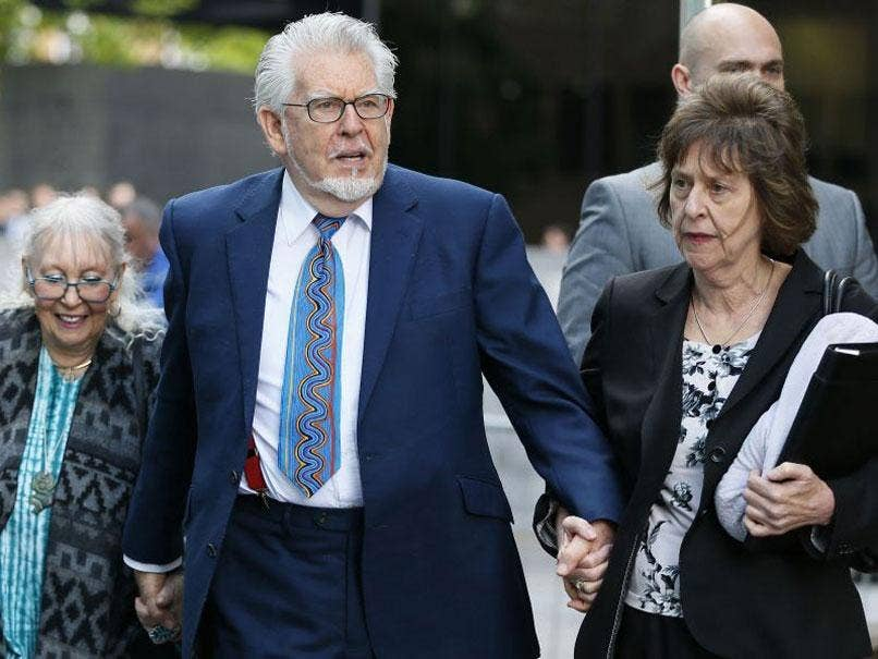 Entertainer Rolf Harris and his wife Alwen Hughes (L) arrive at Southwark Crown Court in central London May 6, 2014.