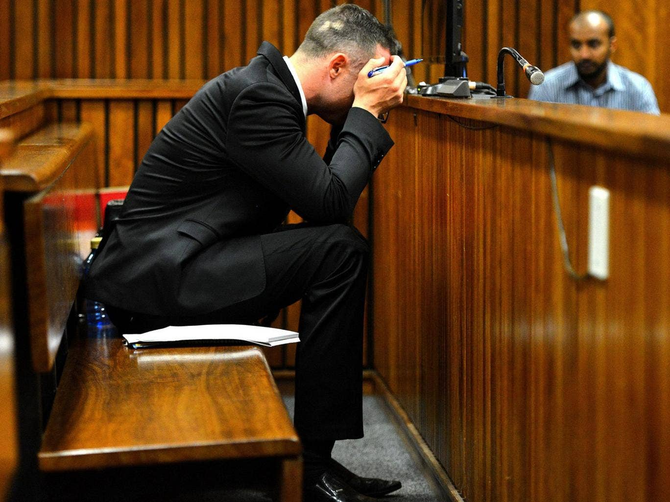 Oscar Pistorius sits in the dock at the high court in Pretoria