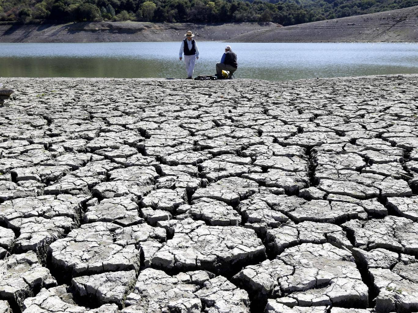 The dry bed of the Stevens Creek Reservoir in Cupertino, California cracks in the summer heat. The decade from 2001 to 2012 was the warmest on record in the United States