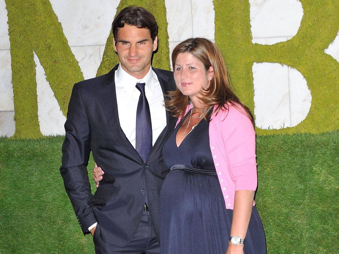 Wimbledon 2009 men's singles champion Roger Federer and his wife Mirka Federer attend the Wimbledon Winners Party at Hotel Intercontinental on July 5, 2009 in London, England.